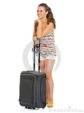 Happy tourist woman with bag looking on copy space