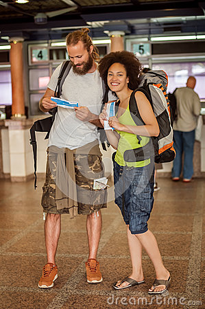 Happy tourists with tickets Stock Photo