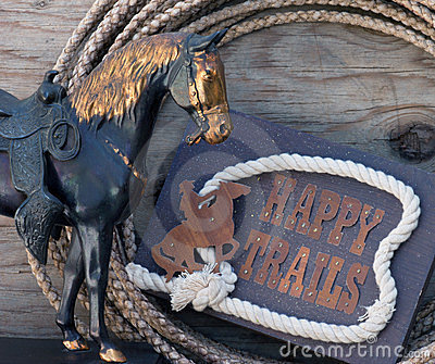 Happy Trails sign with horse statue