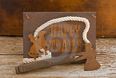 Happy Trails sign with old hatchet