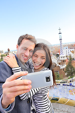 Happy travel couple selfie, Park Guell, Barcelona