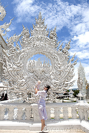 Happy travel mom with a child by Wat Rong Khun