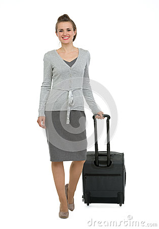 Happy traveling woman with suitcase making step fo
