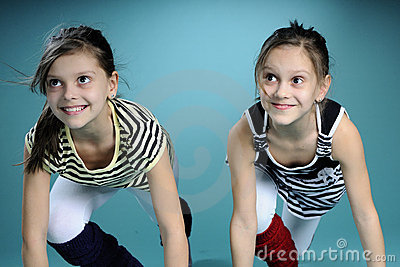 Happy twin sisters listening educator