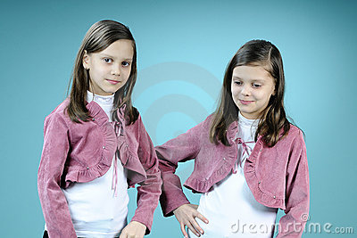 Happy twins posing in studio