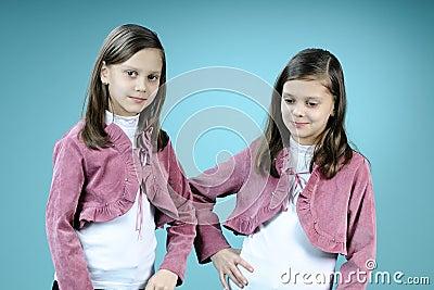 Happy twins posing in studio
