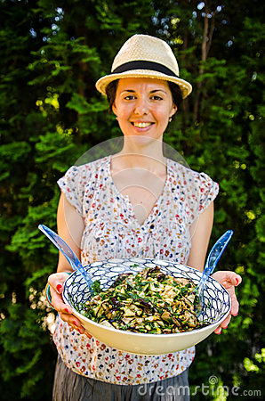 Happy vegetarian woman with salad