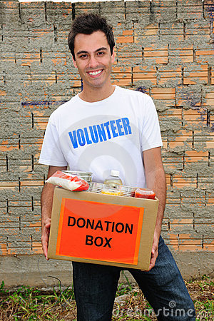 Happy volunteer with food donation box