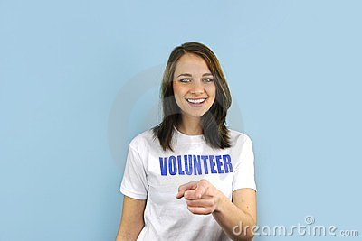 Happy volunteer girl pointing at you