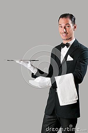 Happy waiter with tray