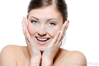 Happy wellness female touching face