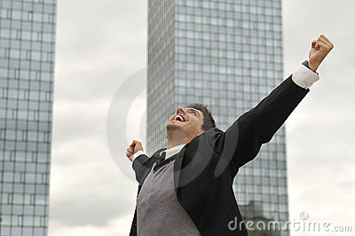 Happy winner businessman  screaming from joy