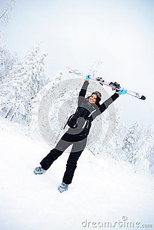 Happy winner female skier