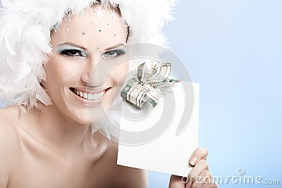 Happy winter beauty holding fancy present