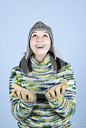 Happy winter girl looking up