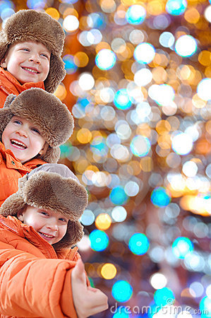 Free Happy Winter Kids Against Colorful Lights Royalty Free Stock Photography - 12470847