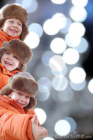 Free Happy Winter Kids Against Colorful Lights Stock Photos - 12890833