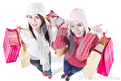 Happy winter shopping with friends - isolated