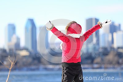 Happy winter woman in city