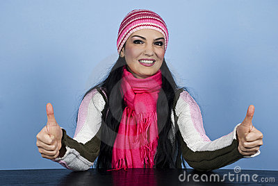 Happy winter woman giving thumbs up