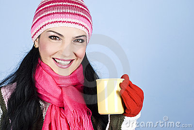 Happy winter woman holding hot drink