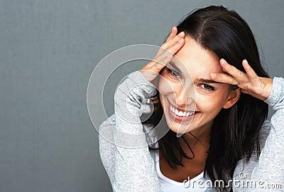 Happy woman acting shy