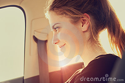 Happy woman in aircraft
