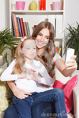 Free Happy Woman And Child Taking A Selfie Stock Photo - 51004300