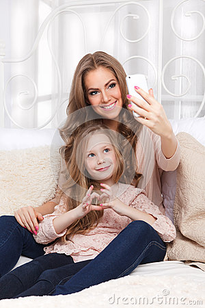 Free Happy Woman And Child Taking A Selfie Royalty Free Stock Photography - 65240297