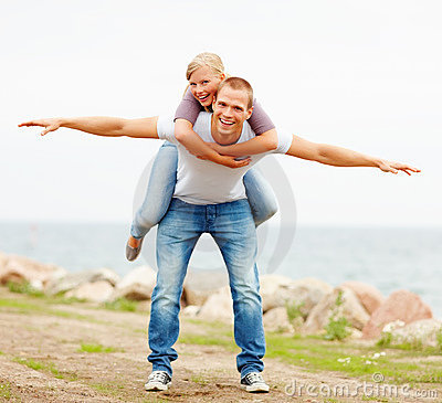Happy woman being carried on a man s back