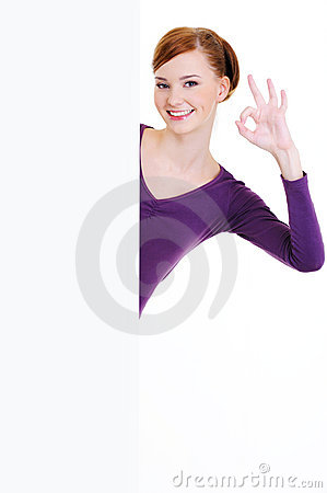 Happy woman and  blank  banner with okay gesture
