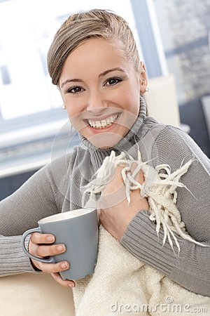 Happy woman with blanket and tea