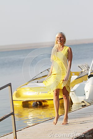 Happy woman on boats background