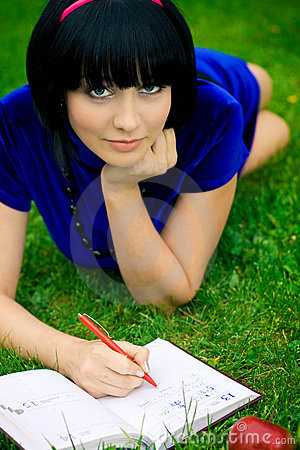 Happy woman with book outdoors