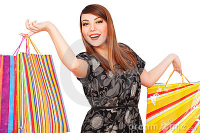 Happy woman with bright shopping bags