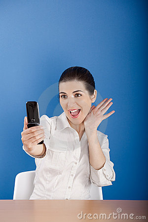 Happy woman calling at phone