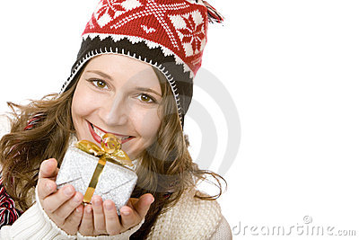 Happy woman with cap is holding Christmas gift