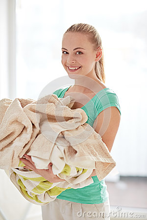 Free Happy Woman Carrying Clothes To Laundry At Home Stock Image - 52511411