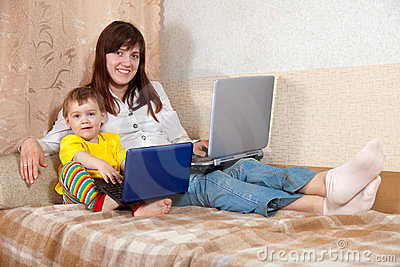 Happy woman and child with laptops