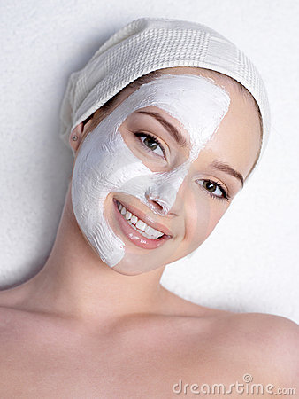 Happy woman with cosmetic mask