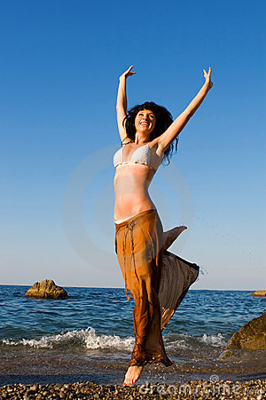 Happy woman dance in the beach
