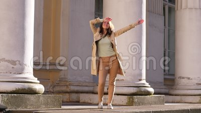 Happy woman dance on street. Excited girl dancing outside stock video
