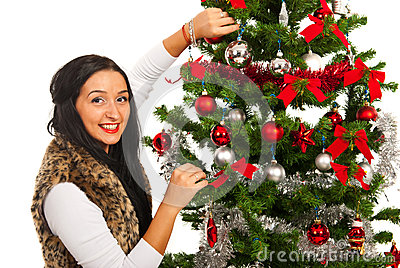 Happy woman decorate Christmas tree