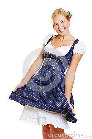 Happy woman in dirndl dancing