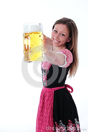 Happy woman in dirndl with a large pint of beer