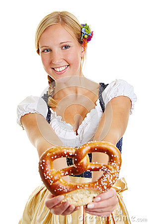 Happy woman in dirndl offering