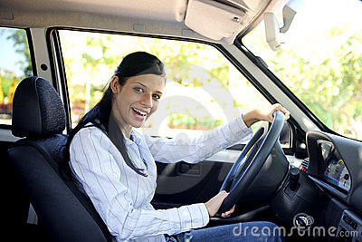 Happy woman driving her new car