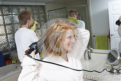 Happy Woman Drying Hair