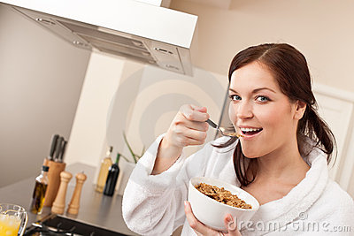 Happy Woman Eating Cereals In Kitchen Royalty Free Stock Image - Image: 13035366