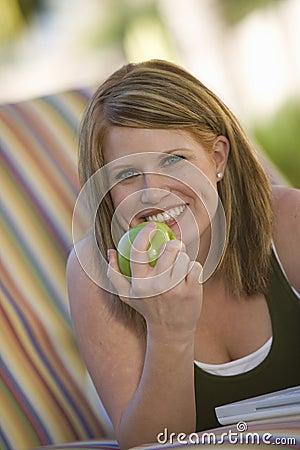 Happy Woman Eating Green Apple